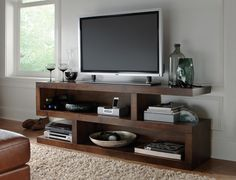 Your Game Day guests will be staring at the television, and this urban console is sure to impress! The Alder II entertainment collection features eclectic pieces with open cubes with shelf space that can function in many different spaces and footprints.