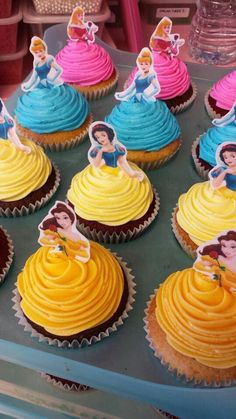 Disney Princess Party Inspiration. Colorful, delightful cupcake ideas featuring Belle, Snow White, Cinderella and more!
