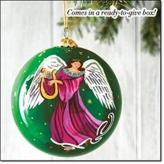 """2015 Hand Painted Angel Ornament Unique, hand-painted design makes this ornament something special for the season. Comes in a box for easy gifting and storing. 3 1/2"""" diam. Glass. Imported. Brochure: $12.99"""