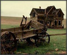 Deserted farm and wagon.