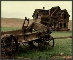 Deserted farm and wagon.