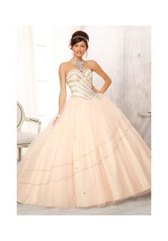 Quinceanera dresses by Vizcaya 88082 Jewel Beaded Bodice on a Tulle Ball Gown Skirt Matching Bolero. Colors Available: Aqua, Champagne, Pink Panther, Coral, Stiletto, White. Sizes Available: 2-24.