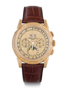 Patek Philippe Reference 5970, manufactured around 2011, has a gold-colored dial. The final sale price at Christie's December 2013 auction was $353,000