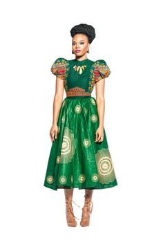This green and detailed flare dress comes with an old-school high shoulder fit top in a lovely dashiki print. Shop gorgeous African-inspired fashion at Kuwala. African Fashion Designers, African Inspired Fashion, Blouse And Skirt, Midi Skirt, Cute Fashion, Fashion Outfits, Fashion Styles, Fashion Ideas, African Dress