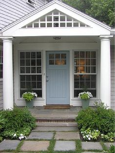 front porch. awesome door. i really like the lattice on the pediment