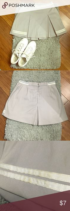 Ladies Tennis Skirt Grey Vintage Ellesse skirt. Throw it back to 90's cool kid. Has a sporty and girly look. The condition is used and has some signs of wear. Offers welcomed! Ellesse Skirts Mini