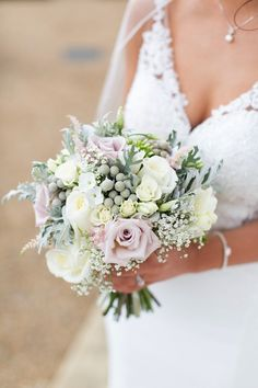 A stunning bridal hand tied of muted lilac roses, ivory flowers and grey foliages Lilac Bouquet, Rose Bridal Bouquet, Lilac Roses, Blush Wedding Flowers, Lilac Wedding, Bridal Flowers, Wedding Bouquets, Wedding Flower Inspiration, Wedding Ideas