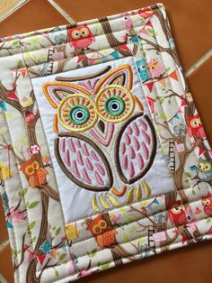 Mola owl embroidered mug rug / over-sized coaster by QuiltingDiva. Fabric: Tree Party designed by Kelly Panacci for Riley Blake Designs