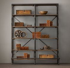 "72"" FRENCH LIBRARY SHELVING  $1695 / 72""W x 24""D x 79""H  A reproduction of a mid-1940s eastern European library bookcase, ours is heir apparent to the imperfect beauty of an antique. Crafted from iron and hardwood, it displays books and other collectibles from 4 open sides. Distressed to replicate its forebear with the patina of age, our shelving's front handles and lower bar step are functional vestiges of its earlier employment, equipping it for moves and reaching the upper tiers as necess..."
