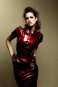 Latex girl wearing a dress that would be considered conservative - except that it's latex. Lovely and sexy.