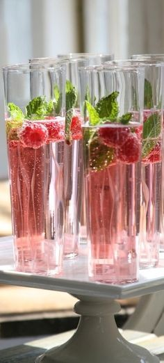 Champagne, cranberry juice, raspberries, and mint.