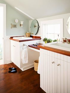 Small Bath Solutions - Covering the vanities in beaded board gives the space cottage flair and provides amble storage for multiple users.