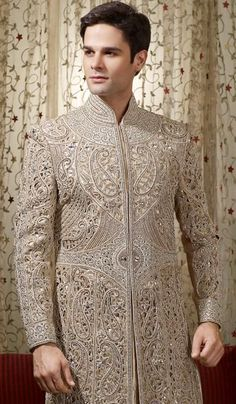 Off Beige Embroidered Wedding Sherwani. Create a smoldering impact by draping this superb shrewani. This fully embroidered shrewani is beautified with diamonds, beads, moti and resham thread. Would love this but in a completely diff colour Sherwani Groom, Mens Sherwani, Wedding Sherwani, Indian Groom Wear, Indian Attire, Indian Wear, Groom Wedding Dress, Wedding Suits, Wedding Dresses
