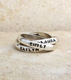 Our Triple and Double name rings are our best sellers! With our stamped triple name ring with interconnecting bands you can create a one-of-a-kind piece of jewelry. Design your ring with three names, dates or words...be creative! The bands move around on your finger so the same name, date or phrase will not always be on top. This ring is a continually changing work of art. There is a maximum of 12 characters per band.