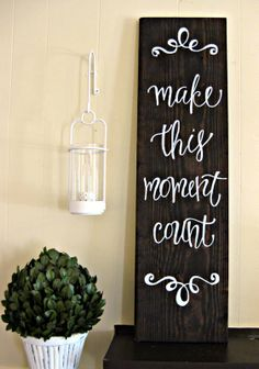 Paint a favorite quote on distressed wood in gorgeous calligraphy