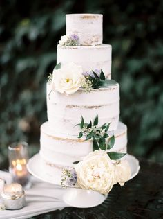 Semi Naked White Wedding Cake with Enchanted Garden Flowers and Glowing Candles