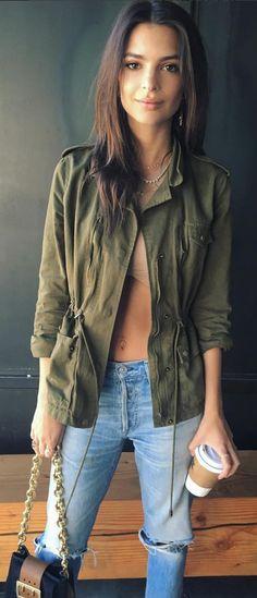 Who made Emily Ratajkowski's green jacket, blue handbag, and ripped jeans?