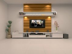 Stretched unit design. The center wooden laminate with white compliments to the richness of space