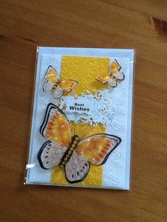 A5 card made with embossed edge folders with a central panel with butterflies on in lovely sunshine yellow with 3 butterfly's 1 large and two small with a Best Wishes sentiment on a die cut butterfly tag from tonic