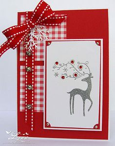 Christmas card with fantasy reindeer and tiny bells...luv the crisp reds and whites...gingham checked paper layer...red ribbon with white stitching...rubies in the deer's antlers...delightful...
