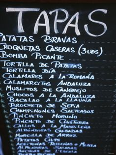 Tapas menu in Spain.  I ate my way through most of these types of tapas one night in Barcelona.  I spent the rest of the night very ILL from overeating.  It was worth it.