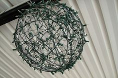 DIY Fairy Light Globe using wire hanging baskets!  Love this!