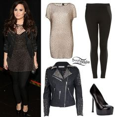 Demi Lovato poses before taking the stage at VH1 Divas on Sunday night. She wore a TopShop Knitted Metallic Mesh Dress ($160.00), a Faux Leather Panel Leggings from TopShop($56.00), a Shampalove Vicious Studded Biker Jacket ($289.00) and a pair of Stiletto Court Shoe from Yves Saint Laurent ($721.89).