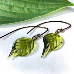 Gleaming glass leaves on antiqued bronze - handmade.   • A unique gift for nature lovers celebrating EARTH DAY & Spring.  • Arrives beautifully boxed & bowed for giving.  • Includes free original-design nature-photography gift card.