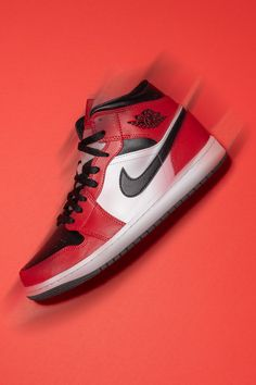 """Expand your style with the Air Jordan 1 Mid """"Black Toe,"""" a shoe inspired by the legendary """"Chicago"""" Air Jordan 1 High worn by Michael Jordan with the Chicago Bulls in the '80s."""