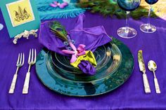 Peacock wedding ideas. Purple with turquoise and green