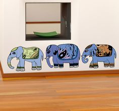 A wall sticker of a set of three beautifully decorated elephants from our collection of animal decals. Give your home an exotic look with this artistic idea. #Elephants #Sticker #Decoration