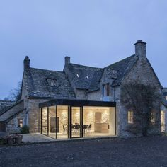 Yew Tree Cottage featured in the Contemporist article '14 examples of British Houses with contemporary extensions'. This traditional stone house got a contemporary extension built from glass to create a modern dining area still connected to the existing property but will a new atmosphere. The existing external stone walls were kept so that the two faces that the glass box was joined to showcased the beautiful aesthetic of the stone. See which other projects were named within the article here…