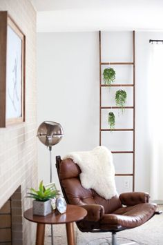http://www.refinery29.com/a-beautiful-mess/14#slide-3  Hanging Plant DisplayHouseplants add such a fresh and cozy feel to a home, but if you've run out of surfaces for your potted plants, have no fear! You don't need to hang a hook in your wall or ceiling to display hanging plants — all you need is a leaning ladder, hanging pots, and some large S-hooks.If the windows in your home aren't giving your plants the light they want, you can also hang a clamp light on the ladder for supplementary…