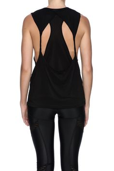 Black spandex blend tank with jersey knit fabric, back cut out with mesh details.   Spaulding Black Tank by Lovers + Friends. Clothing - Activewear Houston, Texas