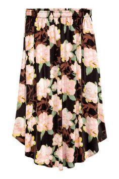 Wzorzysta spódnica: Spódnica z krepowanej tkaniny wiskozowej we wzorzyste nadruki. Elastyczna talia, zaokrąglony dół. Bez podszewki.