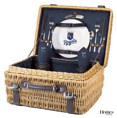 A great alternative to tailgating –– a deluxe picnic for two! The Champion picnic basket includes porcelain plates, wine glasses, corkscrew, napkins and stainless flatware. $167. picnictime.com
