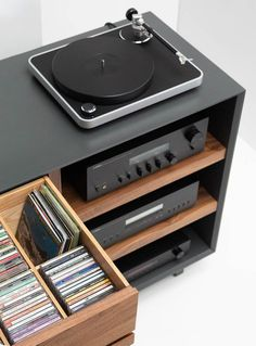 With adjustable solid wood shelves and storage for up to 120 LPs, the AERO Audio Rack is premium custom media furniture. Order yours from Symbol! Cd Storage, Vinyl Record Storage, Vinyl Shelf, Home Music Rooms, Stereo Cabinet, Tv Stand Console, Record Player Console, Audio Room, Vinyl Records