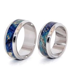 Love's Pulse and Whispers Set. This beautifully crafted, titanium wedding ring set has generous center inlay of Blue Box Elder for each band. Polished with a mirror finish. Constrated nicely with stan