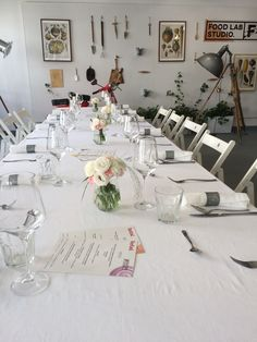 Table in Food Lab Studio designed for Business lunch #glass #linen #flowers #white #menu #food #table #design