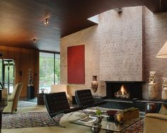 LOVE... the skylight over the fireplace, talk - floor to ceiling fireplace, wood ceiling!