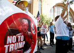 Hundreds of Latinos protest at Trump rally, clash...