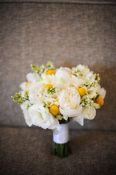Butter yellow peonies, freesia and billy balls