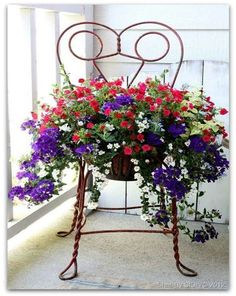 Really pretty. Beautiful pot of course! But I would have to file this under Yard Art because I just love this artsy chair to hold the planter! Both are really nice! Yard Art, Container Plants, Container Gardening, Container Flowers, Chair Planter, Deco Floral, Amazing Decor, Garden Chairs, Garden Projects