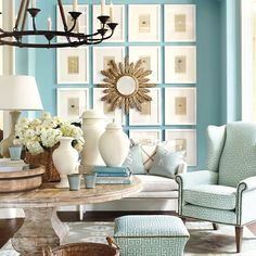 Over at How To Decorate…you will find this very uplifting cheery room decked out in shades of aqua…this one just seems to make you happy and oh so welcome. i adore how they layered the mirror over the framed artwork…it simply works!
