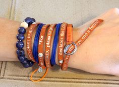 Layering doesn't have to break the bank! Here we've used a Good Works Inspiration Torino Bible Verse Bracelet with Crystals as our foundation $32, then added 2 blue Pura Vida bracelets and a beaded acai bracelet from The Andean Collection for texture. These pieces are available at our online boutique www.Hangin-Around.com