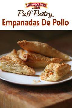 Puff Pastry Empanadas De Pollo Recipe. Inspired by the signature Argentinian dish, these empanadas are stuffed with shredded chicken, paprika, onion, garlic and olives.  Baked fresh in your oven, these Empanadas de Pollo are a great take-along for any pot luck, picnic or fiesta.