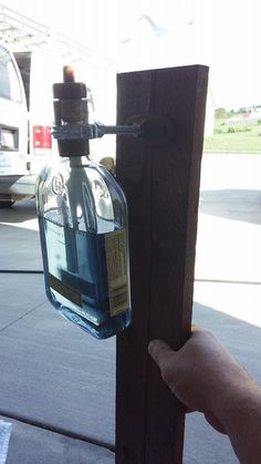 Repurposed Woodford Reserve bottles as tiki torches!