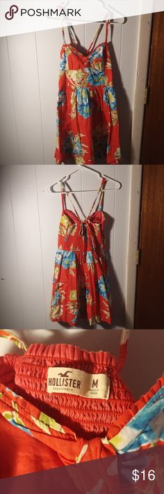 Adorable Hawaiian dress Cute summer dress. The back ties as to adjust the straps. Size medium by hollister Hollister Dresses Midi