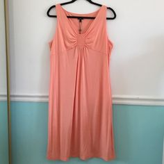 Talbots lightweight sleeveless dress Talbots spring and summer dress. Sleeveless, v-neck new lightweight dress in size large. Pretty peachy orange. Brand new - ready for spring or a getaway trip. Dress is a stretchy material. Size Large.                                                                          Top of Shoulder sem to bottom hem is 42 inches.                                                                          Armpit to armpit is 20 inches Talbots Dresses