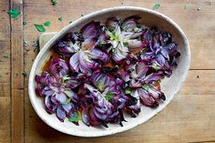 God I'm a sucker for this combo: fabulous photography and grilled vegetables. Roasted Red Onion Flowers and other onion recipes at Epicurious.com